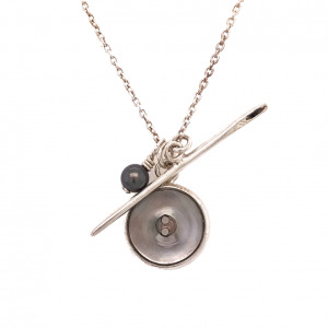 needle and mother of pearl button pendant necklace